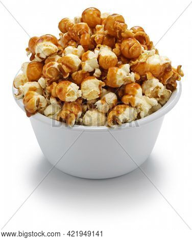 homemade caramel popcorn in bowl isolated on white background