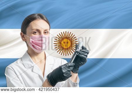 Girl Doctor Prepares Vaccination Against The Background Of The Argentina Flag. Vaccination Concept A