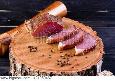 Dried Pork, Polendwitz, Jerky Tenderloin On Wooden Background. Cured Pork Meat. Polenitsa Is A Dry-c