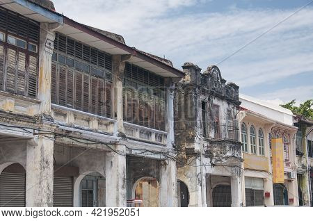 Penang, Malaysia.  August 19, 2017. Weathered Buildings Lining The Streets Within The Georgetown Are