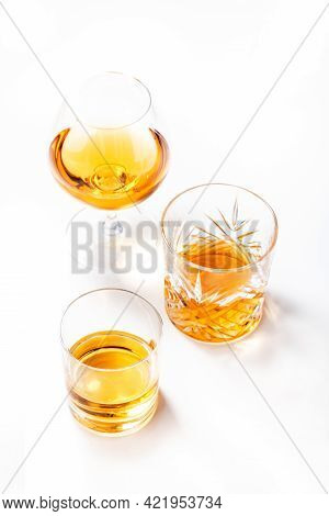 Strong Alcoholic Drinks, Spirits And Distillates In Glasses: Vodka, Cognac, Scotch, Whiskey And Othe