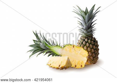 Pineapple Fruit And Pineapple Slices Isolated On A White Background.