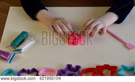 Toddler Forming And Shaping Pink Toy Clay By Fingers. Play Dough Mold Set For Enhancing Fine Motor S