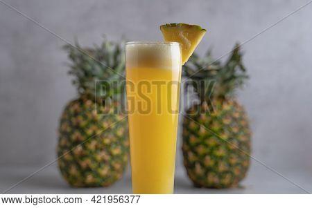 Refreshing Freshly Made Fruit Juice On A Glass , Fresh Pineapple Juice.