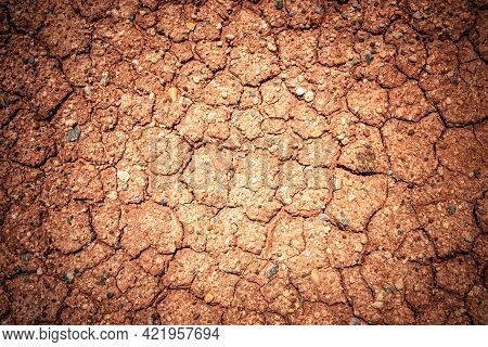 Full Frame To Terrain With Arid Climate. The Surface Of The Land Is Cracked. Crack Soil Ground Textu