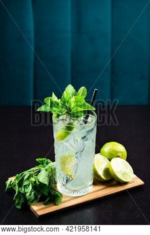 Cold Fresh Lemonade Drink On A Wooden Table
