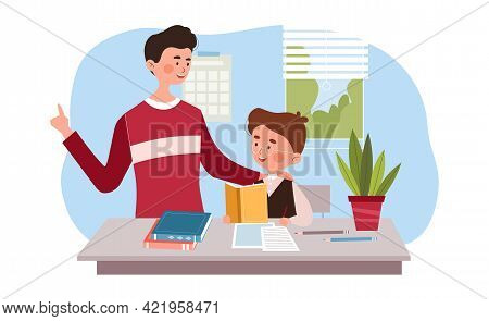 Young Father Is Helping His Little Son To Do Homework. Dad Is Helping His Son To Learn A School Subj