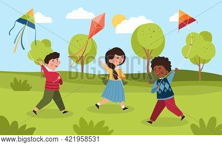 Three Happy Smiling Diverse Little Children Are Playing With Kites Outdoors In A Park. Kids Spending