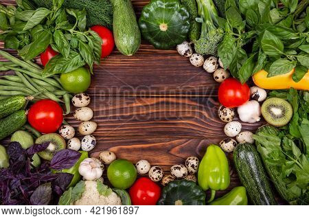 Frame Of Assorted Fresh Vegetables. Still Life. Ripe Vegetables. High Angle Of Wooden Cutting Board