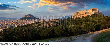 Panorama of famous greek tourist landmark - the iconic Parthenon Temple at the Acropolis of Athens as seen from Philopappos Hill on sunset. Athens, Greece