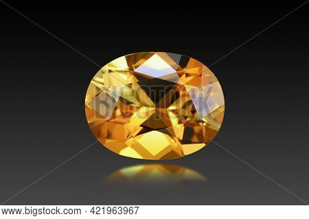 Natural Golden Yellow Loose Tourmaline Oval Faceted Gemstone. Dark Background Isolated. Reflection,