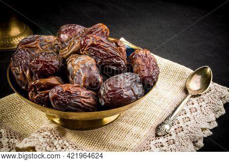 Big Luxury Dried Date Fruit In Bowls On A Linen Napkin, Kurma Ramadan Kareem Concept, Close Up.