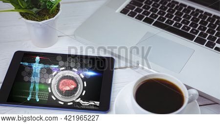 Composition of laptop and tablet showing virtual medical research data interface screen on desk. global medicine, research and digital interface concept digitally generated image.