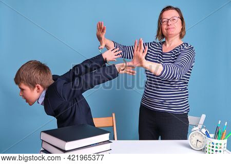 A Woman Holds A Boy In A School Uniform In Handcuffs, Arrest On A Blue Background. Problems With The