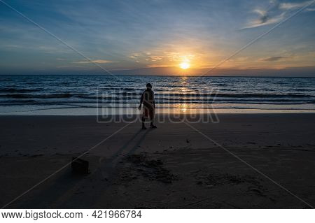 Silhouette People With Beautiful Idyllic Seascape Sunset View On Kohkood Island In Low Season Travel