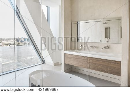 Spacious Master Bathroom With Cabinet Basin And Soaking Tub And Shower Glass Cabin