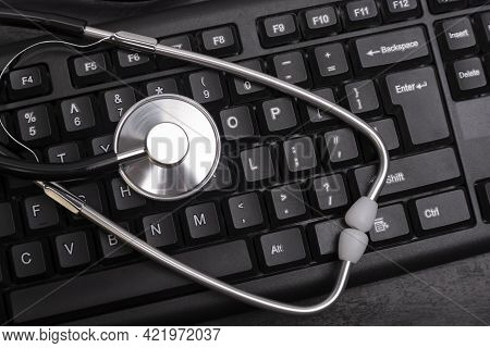 Stethoscope On Computer Keyboard. Online Consultation With A Doctor. Computer Anti-virus Protection