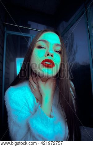 Beautiful Young Brown-haired Girl Art Portrait On The Balcony.