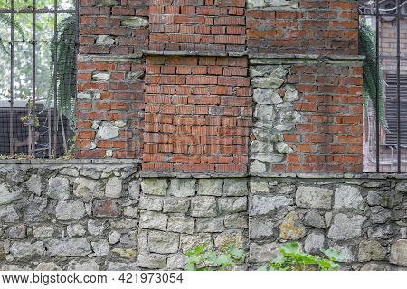 Embossed Texture Of Old Facade Brick Wall