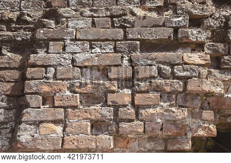 Red Brick, Part Of The Ruins And Ruined Walls Of Medieval Buildings , Close Up. Antique Brickwork. T