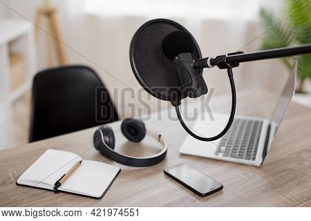 Podcast, Content Making And Blogging Concept - Workplace With Computer, Microphone And Headphones Fo