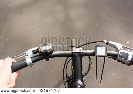 Bicycle Handlebar While Driving, First-person View Of The Bicycle Handlebar And The Road While Ridin