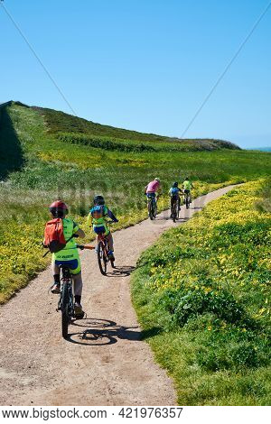 May 5, 2018 - La Coruña, Galicia, Spain: Group Of Cyclists Riding Their Bikes On The Road Next To Th