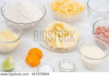 Ingredients To Prepare A A Delicious Cheese And Ham Tartlet