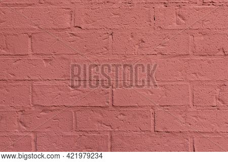 Terracotta Brick Painted Wall Textured Background Close-up.