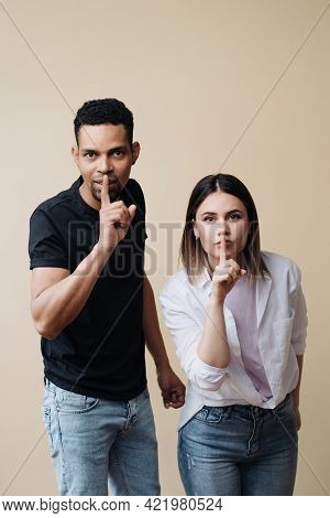 Mixed Race Couple Make Shush Gesture With Surprised Expressions, Ask Not Spread Gossips, Isolated Ov