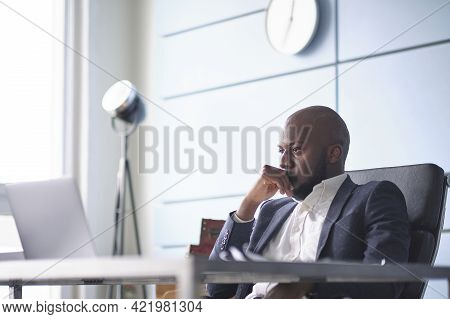 Difficult Conversation With A Customer. African American Man Talking On Phone, Hearing Bad Unexpecte