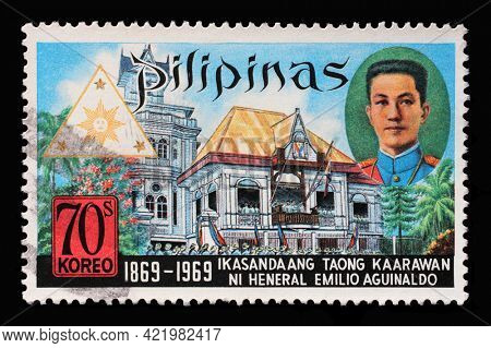ZAGREB, CROATIA - SEPTEMBER 18, 2014: Stamp printed in Philippines from the Birth Centenary of President Emilio Aguinaldo issue shows President Aguinaldo and Cavite Building, circa 1969.