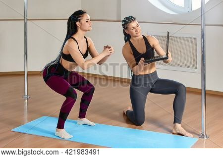 E-learning Exercises For Strength And Flexibility In An Pole Acrobatics Studio, Woman Gymnast Watche