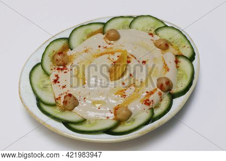 Lebanese And Turkish Hummus Dip Known As Mezze In A Plate