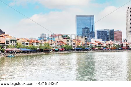 Bars And Restaurants Along Historic Boat Quay On The Singapore River.