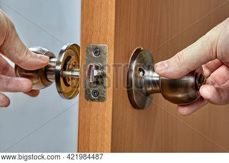 Assembling Lock With Door Knobs And Latch In Living Room.