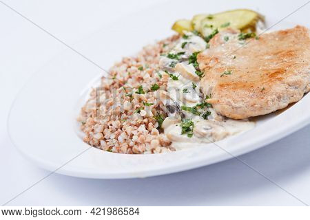 buckwheat with meat on white table