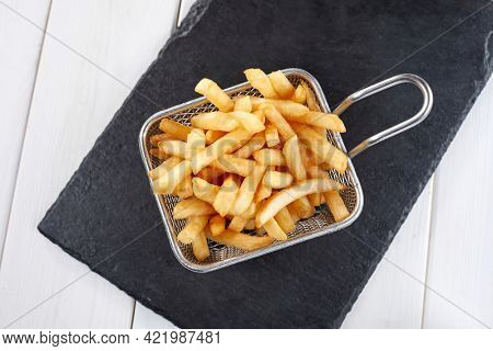 fried french fries in the basket