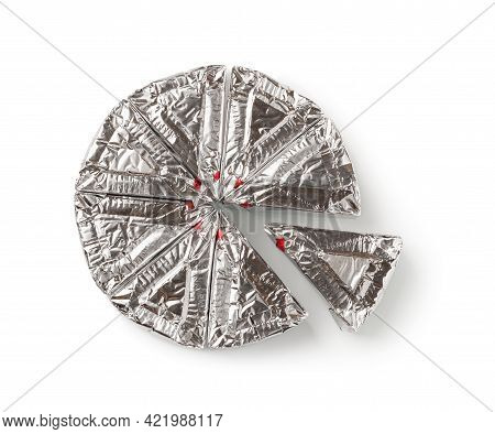 Wheel Of Foil Wrapped Processed Cream Cheese Slices Isolated On A White Background. Portioned Soft C