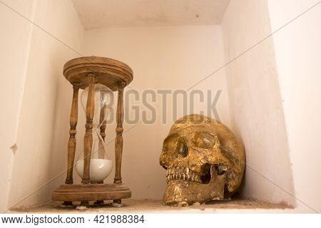 Tarragona, Spain, May 1, 2020 - Skull And Hourglass In Monk Cell On Old Monastery Cartoixa Escaladei