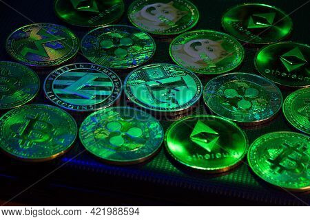 Bitcoins And Altcoins Over Dark Surface In Neon Light