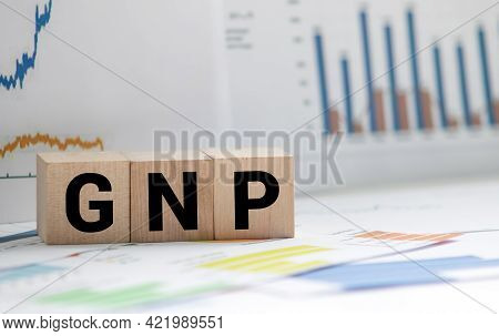 Gnp Gross Domestic Product Word Made With Wooden Blocks On Grey Blue Background.