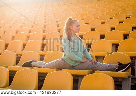 Best Exercise. Workout On Fresh Air. Confident Gymnast With Flexible Body. Teen Girl Warming Up On S