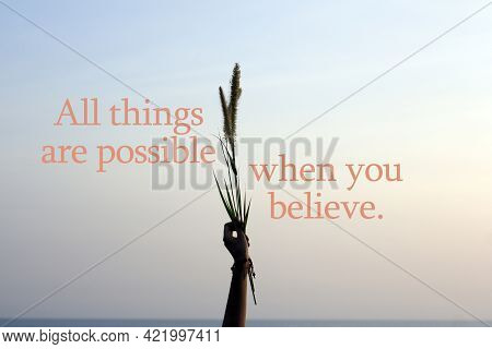 Inspirational Words - All Things Are Possible When You Believe.  With Arm Of Young Woman Raised Hold