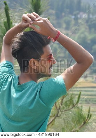 Back View Of A Young Guy Wearing Sunglass And Posing In Outdoor