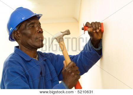 Construction Worker Holding Hammer