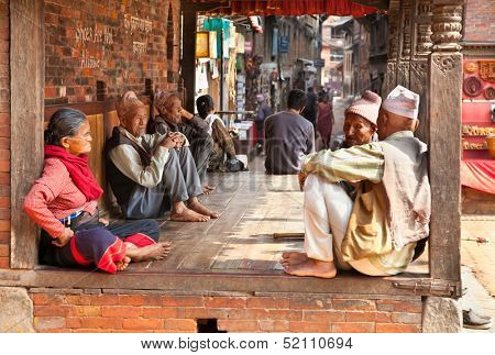 BHAKTAPUR - MAY 20 : Unidentified Tharu old people besides the street of Bhaktapur, Nepal on May 20, 2013. Tharu are an ethnic group from west part of Nepal.