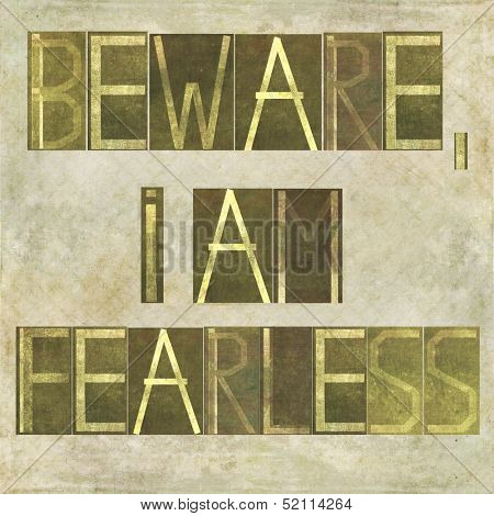 "Earthy background image and design element depicting the words ""Beware, I am fearless"" poster"