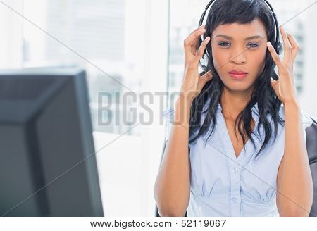Exasperated operator looking at camera in office