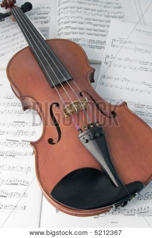 Violin Resting On Music Scores
